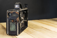 Very old handheld video camera on wooden desk Royalty Free Stock Photo