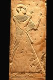 Upper class Egyptian woman at ancient hieroglyph, Luxor, Egypt. Details of a very old hieroglyphic artwork in Luxor, Egypt Stock Image