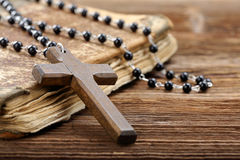 Very old holy bible and wooden cross Royalty Free Stock Images