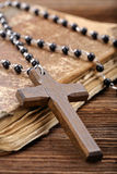 Very old holy bible and wooden cross Royalty Free Stock Image