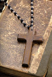 Very old holy bible and wooden cross Royalty Free Stock Photos