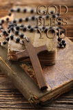 Very old holy bible and wooden cross Royalty Free Stock Photography