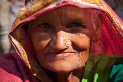 Very old indian villager woman. With dark complexion  looking at camera Royalty Free Stock Photo