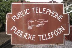 Very old information sign about a public telephone, Africa Stock Photography