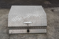 Very old iron metal storage trunk or box on concret floor Royalty Free Stock Images
