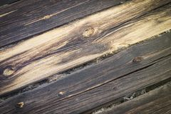 Very old logs of the house wall, horizontal, tow, cracks, defect Stock Photos