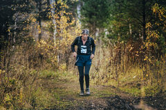 Very old man athlete running in autumn forest. Beloretsk, Russia -  September 26, 2015: very old man athlete running in autumn forest during marathon mountain Stock Photos
