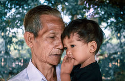 Very old man and two years old baby. Royalty Free Stock Images
