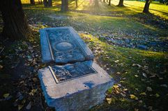 Cracked grave marker in a park royalty free stock photo