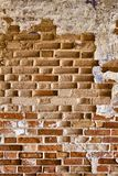 Very old brickwork. Very old masonry made of red brick. Wall with fallen off plaster Royalty Free Stock Photo
