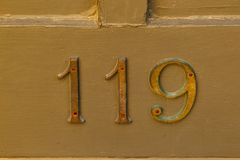 Very old metal numbers on the side of a building. Very old metal address numbers on the side of a building Stock Photo