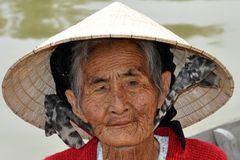 Very old native woman from Vietnam with the traditional hat Stock Images