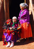 Very old Navajo woman with her daughter. 99 year old Navajo woman with her daughter in front of a traditional Hogan dwelling Royalty Free Stock Photos