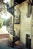 Very old outdoor spiral staircase. Europe Royalty Free Stock Photo