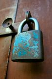 Very old padlock. Very old blue padlock. Not so reliable Royalty Free Stock Photo