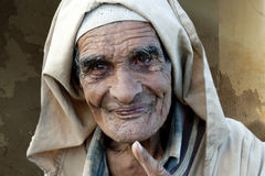Wrinkled old and friendly man in Morocco Stock Photos