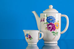Free Very Old Porcelain Tea Set On Blue Reflection Background Royalty Free Stock Photography - 80311267