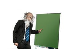 Very old professor points to the blackboard Stock Photo