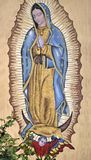Our Lady of Guadalupe. A very old representation of Nuestra Señora de Guadalupe, in the church of Sabana Grande, Honduras.  A large and beautiful painting or Stock Photo