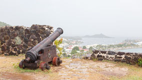 Very old rusted canon pointing at a bay Royalty Free Stock Photo