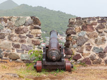Very old rusted canon on top of an old wall Royalty Free Stock Photography