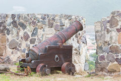 Very old rusted canon on top of an old wall Stock Image