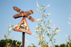 Very old rusty road sign with a train picture - railroad crossing Stock Image