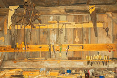 Very old rusty woodworking tools on the wall in the workshop Royalty Free Stock Images