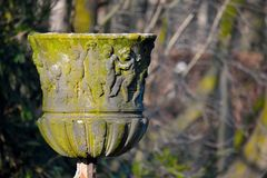 Very old sculpted stone vase Royalty Free Stock Photos