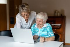 Very old senior woman learning to use a computer royalty free stock photos