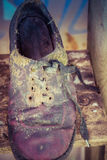 Very old shoe. On a shelf Royalty Free Stock Photo