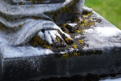 Very old statue in a cemetery. Very old statue / headstone in a cemetery royalty free stock images