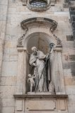 Very old statute of high ranked priest with winged angel in historical downtown of Dresden, Germany. Details, closeup royalty free stock images
