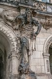 Very old statute of scary gatekeeper, medieval warrior with weapon in historical downtown of Dresden, Germany. Details, closeup royalty free stock photography