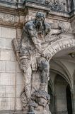 Very old statute of scary gatekeeper, medieval warrior with weapon in historical downtown of Dresden, Germany. Details, closeup stock photos