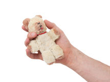Very old teddybear. In the hand of a man Royalty Free Stock Images