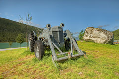 Very old tractor in field Royalty Free Stock Image