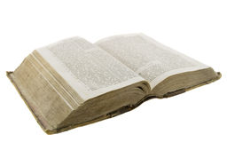 Very old vintage bible open for reading. Isolated over white background Stock Image