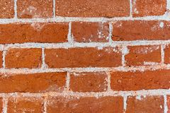 Old brick wall texture of red stone blocks closeup royalty free stock photos