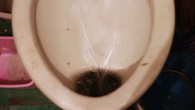 Very old vintage toilet in which water flows. Old, unkempt, dirty toilet. Water flows from the storage tank. Flush old, untidy wc, water splash in toilet stock video