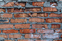 Very old wall. Old fence made of red brick royalty free stock photo