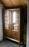 Very old wardrobe. Very old antique wardrobe furniture in the loft Stock Images