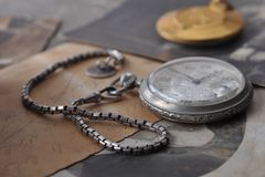 Very old watch on the grunge post card Stock Image