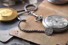 Very old watch on the post card Stock Photos