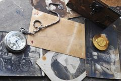Very old watch on   post card and photo Royalty Free Stock Photo