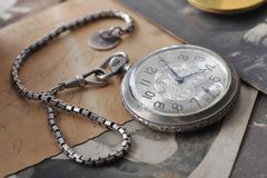 Very old watch on the post card and photo Royalty Free Stock Photos