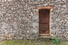 Very old weathered brown door made of wood stock photography