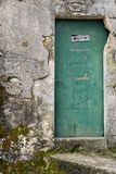 Very old weathered green door made of wood. House entrance in Beli Island Cres, Croatia royalty free stock photos