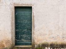 Very old weathered green door made of wood. Island Cres, Croatia royalty free stock photos
