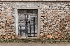 Very old weathered small door made of wood. Stone house Island Cres, Croatia stock images